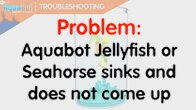 jellyfish and seahorse sinking